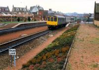 Hybrid DMU heads north from Larbert past the old station building.<br><br>[Ewan Crawford&nbsp;//1988]