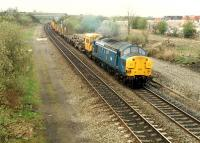 A 37 pulls a permanent way train south past the former Plean station.<br><br>[Ewan Crawford&nbsp;//1988]