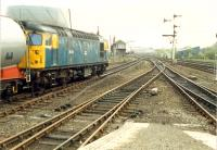 26 015 waits with southbound freight at Stirling. The goods yard at Stirling is no more.<br><br>[Ewan Crawford&nbsp;//1988]