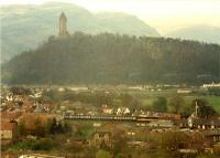 Approaching Stirling from the north. Viewed from Stirling Castle and the Wallace Monument and Ochil hills provide a backdrop.<br><br>[Ewan Crawford&nbsp;//1988]