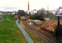 Alloa looking east over the former junction between the Devon Valley line (left, lifted) and Dunfermline line (not lifted). This was the east end of the station. The bridge carried the Alloa Waggonway.<br><br>[Ewan Crawford&nbsp;//1988]