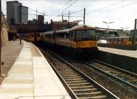 Three trains at Motherwell. Local (left probably for Lanark), long distance (centre) and local (right probably for Hamilton).<br><br>[Ewan Crawford&nbsp;//1988]