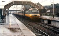 In a very heavy downpour a 125 diverted from the ECML heads north through Lockerbie.<br><br>[Ewan Crawford&nbsp;//1988]