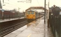 Heading north in the rain. The Dumfries platforms were to the right.<br><br>[Ewan Crawford&nbsp;//1988]