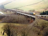 Southbound train crosses the Harthope Viaduct.<br><br>[Ewan Crawford&nbsp;//1988]