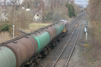 Oil train heading north from Dumfries behind a class 60 in April 2006 passing the abandoned junction for the former Stranraer line.<br><br>[John Furnevel&nbsp;17/04/2006]