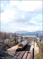 Clouds forming over the Pentland Hills in April 2006 as an Edinburgh bound service from North Berwick pulls into Wallyford station.<br><br>[John Furnevel&nbsp;/04/2006]