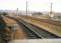 Just south of Strathclyde Junction is this view looking south to Rutherglen. The yard on the left is Bridgeton Yard for the Civil Engineer. The line to the right is the low level Glasgow Central line. Beyond that is the railway training school.<br><br>[Ewan Crawford&nbsp;//1988]