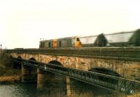 A pair of 20s crosses the Clydebridge viaduct heading west with a train of empty coal wagons.<br><br>[Ewan Crawford&nbsp;//1988]