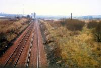 Carmyle looking west. From left to right; Norit works (still there), route to Rutherglen, demolished Clyde Iron (and distant Clydebridge Steelworks), route to Glasgow Central Low Level.<br><br>[Ewan Crawford&nbsp;//1988]