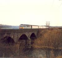 Diverted eastbound 477 crossing the Clydebridge Viaduct.<br><br>[Ewan Crawford&nbsp;//1988]