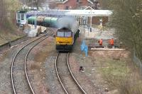 The driver of a northbound oil train applies the boot after passing through Dumfries station in April 2006.<br><br>[John Furnevel&nbsp;17/04/2006]