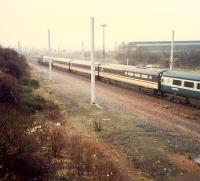 Southbound express passing Shieldmuir Yard. The steelworks in the background only provided scrap for Ravenscraig by this date. Now the site of a Post Office depot.<br><br>[Ewan Crawford&nbsp;//1988]