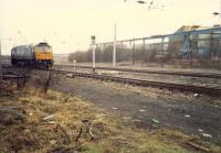 A 47 creeps up to the signal at the entry for Shieldmuir Yard which gave access to the Netherton Branch - a steelworks only in use for scrap provision for Ravenscraig by this date. This site is now Shieldmuir station and the yard is lifted.<br><br>[Ewan Crawford&nbsp;//1988]