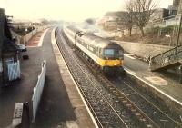 Diverted from the E&G is a 477 hammering through Shotts on a Glasgow to Edinburgh service.<br><br>[Ewan Crawford&nbsp;//1988]