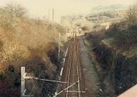 Looking east away from the eastern portals of the two Wemyss Bay Cartsburn tunnels. The line was originally single track and a second, now redundant, bore was required. In the middle distance the line was crossed by the G&SW line.<br><br>[Ewan Crawford&nbsp;//1988]