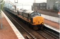37 406 heads west with a West Highland timber train.<br><br>[Ewan Crawford //1990]