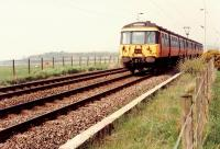 311 098 approaching Ardmore Level Crossing going east.<br><br>[Ewan Crawford&nbsp;//1990]