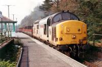 The lunchtime speedlink to Crianlarich enters Arrochar and Tarbet. Hauled by 37 403<br><br>[Ewan Crawford&nbsp;//1990]