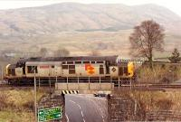 Not something you see every day, 37 403 effectively being reversed to Crianlarich from Crianlarich Lower Junction. This bridge and another just west (both on this short spur) are contributors to the proposed Crianlarich bypass.<br><br>[Ewan Crawford&nbsp;//1990]