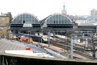 Full width view of Kings Cross showing all three trainsheds in July 2005. The station's <I>Eastern Range</I> building is on the left of the picture with the St Pancras clock tower in the right background.<br><br>[John Furnevel&nbsp;/07/2005]