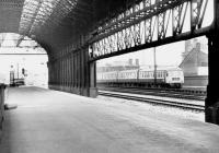 Trans-Pennine DMU passing the west end of the out-of-use Manchester Exchange in late 1970. The station's platform 3 became part of Britain's longest railway platform at 2,238 feet when it was extended east in 1929 to join up with the west end of Manchester Victoria's platform 11.<br><br>[John Furnevel&nbsp;20/11/1970]