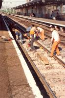 <i>Ive been working on the railroad ...</i> using pneumatic drills and earmuffs to cover the sound of 37s at Dumbarton Central.<br><br>[Ewan Crawford&nbsp;//1990]