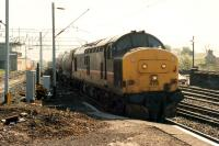 37 406 enters Dumbarton Central with a Mossend-Fort William freight.<br><br>[Ewan Crawford&nbsp;//1990]
