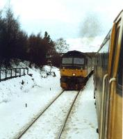 Southbound train passing a stopped nortbound train at Tomatin.<br><br>[Ewan Crawford&nbsp;//1989]