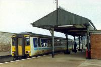 Westbound Sprinter entering Forres. The canopy is part of the old station building. This station opened with the line to Perth and replaced another station well beyond the station wall on the left.<br><br>[Ewan Crawford&nbsp;//]