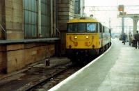 Empty stock being brought into platform 1 at Central. However as the WCML was closed this was to leave, 47 hauled, via Paisley and Ayr for the south.<br><br>[Ewan Crawford 26/11/1988]