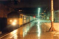 Finally, running about 2 hours late, the Edinburgh portion of a combined Edinburgh and Glasgow train to Inverness arrives at Perth on 3 January 1989.<br><br>[Ewan Crawford 03/01/1989]