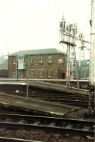View looking east across the platform ends showing the semaphore signals and Stirling goods office.<br><br>[Ewan Crawford&nbsp;//]