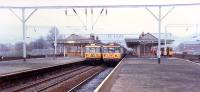 Three trains in Dumbarton Central.<br><br>[Ewan Crawford&nbsp;//1988]