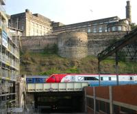 Trains held on New Street bridge on the eastern approach to Waverley on Sunday morning 30 April 2006. Under construction on the left is the new Edinburgh Council HQ, part of the Waverley Valley development, while on the right is the top floor of the former New Street bus depot, currently undergoing demolition as part of the same project.<br><br>[John Furnevel&nbsp;30/04/2006]