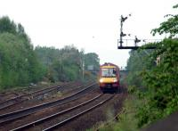 The last splitting distant in Britain. A Glasgow train southbound approaching Larbert.<br><br>[Ewan Crawford&nbsp;12/05/2006]