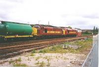 37406 and 37421 are seen at Dalwhinnie with a tanker Train in 2003.<br><br>[John Gray&nbsp;//]