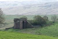 The eastern abutment of Belah Viaduct stands on a remote hillside in the Pennines on the former South Durham & Lancashire Union Railway line over Stainmore.  Photographed from the other side of the valley in May 2006. The shell of the old signal box still stands. <br><br>[John Furnevel&nbsp;11/05/2006]