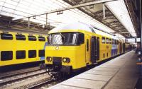NS double deck commuter trains stand side by side at the platforms of Amsterdam Central station on 5 December 1997.<br><br>[John Furnevel&nbsp;05/12/1997]
