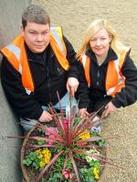 In-Work Ltd members David Steele, from Greenock, and Janette McClumpha, from Port Glasgow, with one of the colourful new planters at Cardonald station [see news item].<br><br>[ScotRail&nbsp;15/03/2012]