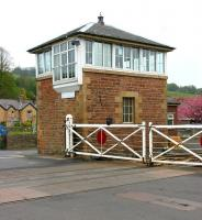 The 1877 signal box at Haydon Bridge in May 2006. The box stands on the north side of the level crossing alongside the 1838 station on the Newcastle & Carlisle line. The crossing is notable as one of the declining number in the UK where crossing gates continue to be mechanically operated by the signalman turning a wheel within the box.<br><br>[John Furnevel&nbsp;06/05/2006]