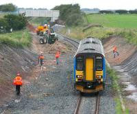 Carlisle - Glasgow service (in Central Trains livery) being waved through the widening works north of Gretna Green station on 3 August 2007.<br><br>[John Furnevel&nbsp;03/08/2007]