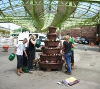 Thirsty work. Friends of Wemyss Bay in action on 30 June 2010. First ScotRail's 'Adopt a Station' policy was recently recognised by way of a NR Community Engagement Award - see news item. <br> <br><br>[Friends of Wemyss Bay&nbsp;30/06/2010]