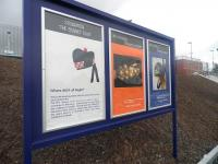 Three of the commemorative posters produced by Stewarton Academy on display outside the town's railway station on 27 April 2010.<br><br>[First ScotRail&nbsp;27/04/2010]