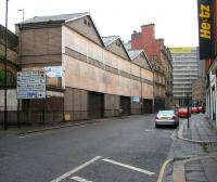 100 years on. The former NER parcels depot of 1906 stands in Westgate Road alongside the east end of Newcastle Central in 2006, with all windows now boarded up. When operational the building was accessible at both road and platform levels [see image 21815]. <br><br>[John Furnevel&nbsp;07/05/2006]