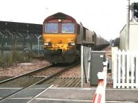 A Longannet coal train on the direct route via Stirling and Alloa about to run over Cambus level crossing on 22 December 2008 behind EWS 66159.<br><br>[John Furnevel&nbsp;22/12/2008]
