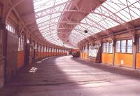 A view down the covered way from Wemyss Bay station to the pier.The glass fronted display units contain the ornamental embellishments from the paddle boxes of long departed paddle steamers.1985<br><br>[John Gray&nbsp;//1985]