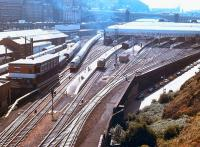View over the east end of Waverley in October 1978, with a class 47 taking a train out of 'sub' platform 21 past the goods depot. The old Waverley East signal box is on the left with the corner of New Street bus depot opposite. The 1977 signaling Centre is in the left background beyond the train.<br><br>[John Furnevel&nbsp;07/10/1978]