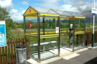 The new HITRANS shelter at Banavie station. New shelters such as these are being installed all over Scotland - the first investment in shelters for some time.<br><br>[Ewan Crawford&nbsp;28/05/2006]