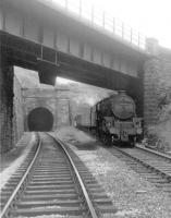 Black 5 44850 leaving Cartsburn Tunnel with a Wemyss Bay to Glasgow Central train in August 1963. The locomotive is about to pass below the bridge carrying the line to Princes Pier. [See image 51451]<br><br>[John Robin&nbsp;13/08/1963]